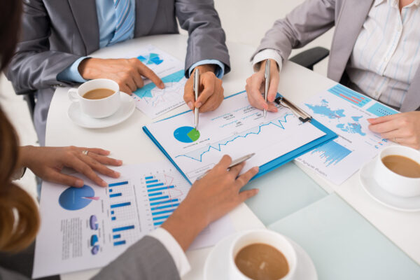 Cropped image of business executives analyzing information in financial charts